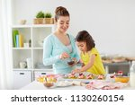 family  cooking and people... | Shutterstock . vector #1130260154