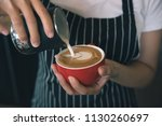 closeup image of female barista ... | Shutterstock . vector #1130260697