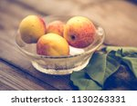 organic apricots on rustic... | Shutterstock . vector #1130263331