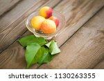 organic apricots on rustic... | Shutterstock . vector #1130263355