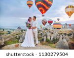couple in love stands on... | Shutterstock . vector #1130279504