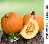 Fresh Pumpkins On Wooden Ground