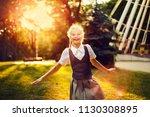 happy schoolgirl in uniform... | Shutterstock . vector #1130308895