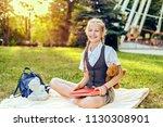 portrait of happy schoolgirl... | Shutterstock . vector #1130308901
