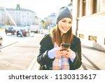 young woman outdoor using smart ... | Shutterstock . vector #1130313617