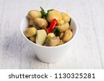 tasty salty pickled mushrooms... | Shutterstock . vector #1130325281
