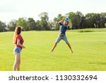 couple in love playing frisbee... | Shutterstock . vector #1130332694