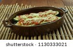 beef stuffed zucchini boats   ... | Shutterstock . vector #1130333021