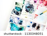used watercolor tray with paint ... | Shutterstock . vector #1130348051