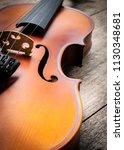 closeup brown violin on wooden... | Shutterstock . vector #1130348681