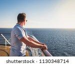 attractive man in sunglasses on ... | Shutterstock . vector #1130348714