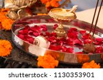 Stock photo hindu puja offering to gods incense rose petals marigold flowers goddess saraswati figure 1130353901