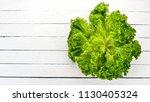 fresh green lettuce. fresh... | Shutterstock . vector #1130405324