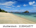 white sand empty beach with... | Shutterstock . vector #1130416577