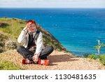 happy smiling redhead women is... | Shutterstock . vector #1130481635