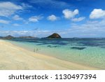 beautiful white sand tropical... | Shutterstock . vector #1130497394