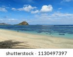 calm empty beach with palm tree ... | Shutterstock . vector #1130497397