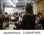 woman gives a public speech in... | Shutterstock . vector #1130497694