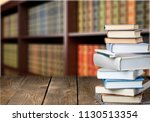 book stack on wood desk | Shutterstock . vector #1130513354