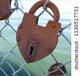 Rusty Padlock Locked On A Dence ...