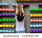 a cute girl playing with a big... | Shutterstock . vector #1130532734
