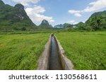 guilin rice mountain range | Shutterstock . vector #1130568611
