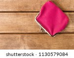 Small photo of Purse on a wooden table . On wooden background .