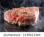 grilled sirloin steak on hot... | Shutterstock . vector #1130611364