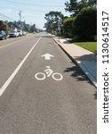 bike path symbol on long beach...   Shutterstock . vector #1130614517