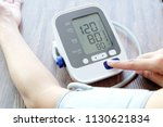 man check blood pressure... | Shutterstock . vector #1130621834