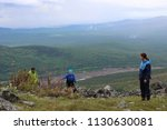 group of tourists guy and two... | Shutterstock . vector #1130630081