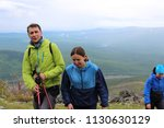 group of tourists guy and two... | Shutterstock . vector #1130630129
