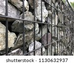 gabion fence close up | Shutterstock . vector #1130632937