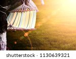 hammock tied to a tree | Shutterstock . vector #1130639321