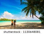 a loving couple on a beach | Shutterstock . vector #1130648081