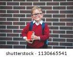 back to school. happy little... | Shutterstock . vector #1130665541