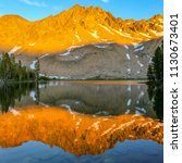 sunset on an alpine lake in the ... | Shutterstock . vector #1130673401