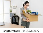 asian woman packing and... | Shutterstock . vector #1130688077