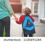 parent taking child to school.... | Shutterstock . vector #1130691284