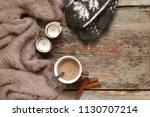 warm soft blanket  cup of hot... | Shutterstock . vector #1130707214
