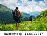 tourists with hiking backpacks... | Shutterstock . vector #1130711717
