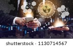 two traders are trading using... | Shutterstock . vector #1130714567