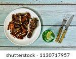 dinner table  fried chicken...   Shutterstock . vector #1130717957