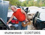 A Man Browses For Car Parts On...
