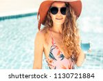 happy young woman wearing... | Shutterstock . vector #1130721884