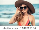 happy young woman wearing... | Shutterstock . vector #1130722184