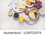 breakfast. oatmeal with berries ... | Shutterstock . vector #1130722574