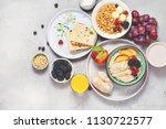 breakfast. oatmeal with berries ... | Shutterstock . vector #1130722577