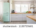 neo mint fridge standing in... | Shutterstock . vector #1130735681