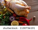 one large raw prepared chicken... | Shutterstock . vector #1130736101